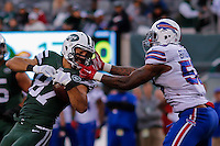 Buffalo Bills, LB, Brandon Spikes tackles New York Jets, WR, Eric Decker during their NFL game at MetLife Stadium in New Jersey. 09.05.2014. VIEWpress