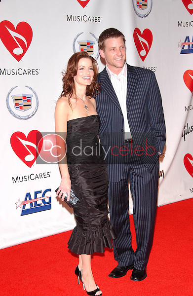 Laura Leighton and Doug Savant<br />at the 2006 MusiCares Person of the Year Gala. Los Angeles Convention Center, Los Angeles, CA 02-06-06<br />Dave Edwards/DailyCeleb.com 818-249-4998
