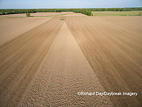 63801-10201 Farmer tilling field before planting corn-aerial Marion Co. IL