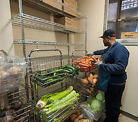 A volunteer stocks vegetables at the West Side Campaign Against Hunger (WSCAH) a supermarket style food pantry on the Upper West Side neighborhood of New York on Friday, December 19, 2014. The clients get to choose their groceries for themselves and their families. In 2014 WSCAH provided food for over 1.1 million meals for nearly 10,000 families. The supermarket-style distribution promotes self-reliance and empowers the clients. (© Richard B. Levine)