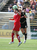 Lisa DeVanna (27) heads the ball against Rachel Buehler (4). FC Gold Pride defeated Washington Freedom 3-2 at Buck Shaw Stadium in Santa Clara, California on August 1, 2009.