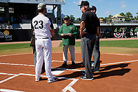 Siena Saints head coach Tony Rossi (40) during the lineup exchange with Greg Lovelady (23) and umpires John Bennett, Jason Werle, and Rick Darby before a game against the UCF Knights on February 17, 2019 at John Euliano Park in Orlando, Florida.  UCF defeated Siena 7-1.  (Mike Janes/Four Seam Images)