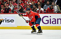 """WASHINGTON, DC - NOVEMBER 03: Capitals left wing Alexander Alex Ovechkin (8) readies for a one-timer from """"his spot"""" on the left face-off circle during the Calgary Flames vs. Washington Capitals on November 3, 2019 at Capital One Arena in Washington, D.C.. (Photo by Randy Litzinger/Icon Sportswire)"""