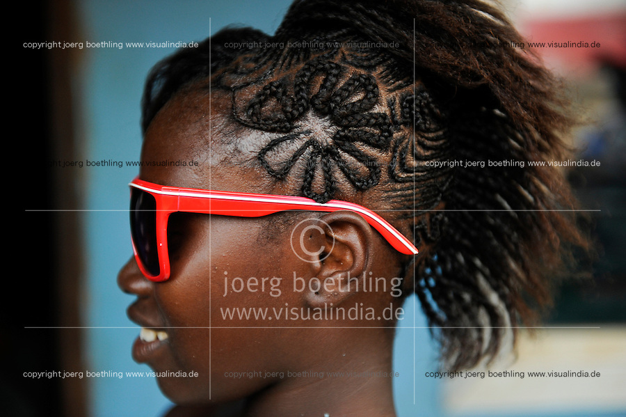 SIERRA LEONE, girl with fancy hair style and sun glasses