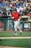Dustin Garneau (4) of the Albuquerque Isotopes trots home after hitting a home run against the Salt Lake Bees in Pacific Coast League action at Smith's Ballpark on June 10, 2017 in Salt Lake City, Utah. The Isotopes defeated the Bees 4-2. (Stephen Smith/Four Seam Images)