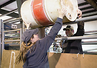 """NWA Democrat-Gazette/CHARLIE KAIJO Don Clark of Lowell (from right) hands a barrel to Jeanie Sims, president of the Northwest Arkansas Horse Show Association, Sunday, March 25, 2018 at the Benton County Fairgrounds in Bentonville. <br /><br />The Benton County Fairgrounds partnered with the Northwest Arkansas Horse Show Association to provide an arena for riders to bring their horses. <br /><br />""""This is a testing the waters kind of thing. WeÕd like to do more of these open ride events, enjoy the fairgrounds and the nice arena,"""" said Susan Koehler, fair and events manager of the Benton County Fairgrounds. """"Especially like today's rainy day. This is an opportunity for them to ride.""""<br /><br />The next event is on April 14. It will include a large horse show with barrel racing, pole bending speed events and an open horse show with judged events like English, Western Pleasure and Ranch Horse events."""