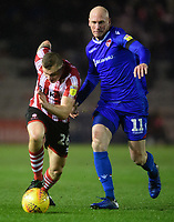 Lincoln City's Harry Anderson vies for possession with Morecambe's Kevin Ellison<br /> <br /> Photographer Chris Vaughan/CameraSport<br /> <br /> The EFL Sky Bet League Two - Saturday 15th December 2018 - Lincoln City v Morecambe - Sincil Bank - Lincoln<br /> <br /> World Copyright © 2018 CameraSport. All rights reserved. 43 Linden Ave. Countesthorpe. Leicester. England. LE8 5PG - Tel: +44 (0) 116 277 4147 - admin@camerasport.com - www.camerasport.com