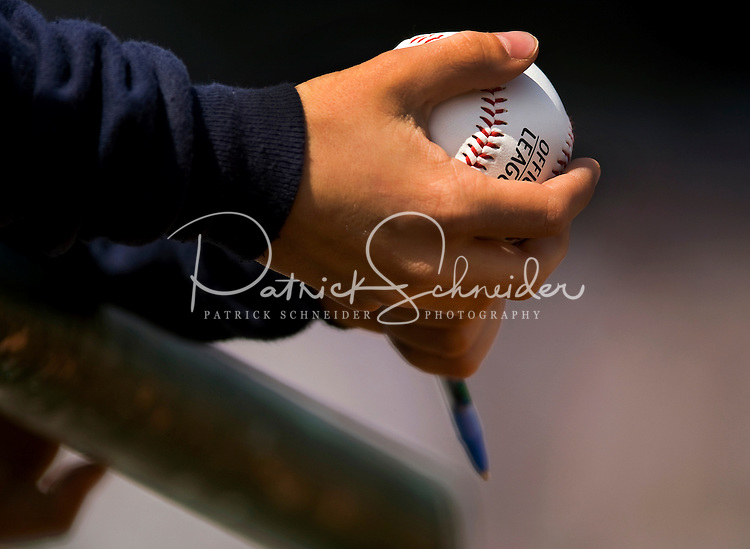 A young fan waits to have his baseball signed during a game of he Charlotte Knights vs. The Durham Bulls, at Knights Stadium in Forth Mill, South Carolina. The Charlotte Knights are the Triple-A affiliate of the Chicago White Sox.