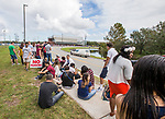 University of North Florida students kill time as they wait in line for four hours on campus to hear President Barrack Obama speaking at a Hillary Clinton vote early rally at the UNF Arena in Jacksonville, Fla., Saturday, Nov. 3, 2016. (AP Photo/Mark Wallheiser)