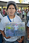 Lucia Marcario Perez holds a photo of her husband Mateo Jose Luis Gutierrez Chicoj during a vigil in Tapachula, Mexico, on December 16, 2013. The Maya K'iche'-speaking Guatemalan woman was part of a group of Central Americans who came to Mexico in search of family members who disappeared there, many while on their way north to the United States. The group, mostly mothers looking for their children, spent 17 days touring 14 Mexican states in search of their loved ones.<br /> <br /> The woman says her husband left their home in Chichicastenango in 2011, and the last she heard from him was when he called three weeks later from the Mexico-U.S. border to say he was about to cross the desert.
