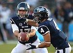 Nevada quarterback Cody Fajardo hands off to Kendall Brock during the first half of a college football game in Reno, Nev., on Saturday, Sept. 7, 2013. (AP Photo/Cathleen Allison)