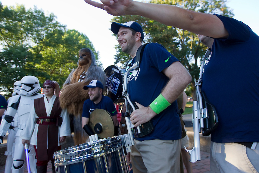 Jared Porter (2nd R) of Blue Thunder poses with other members of a Seahawks percussion group with Starwars characters in Marshall Park in Vancouver Friday July 15, 2016. A star wars movie was shown following a Seahawks event. (Photo by Natalie Behring/ for the The Columbian)