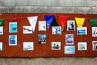 Pictures of former Greasy Pole Contest winners hang on a wall on Commercial Street in Gloucester, Massachusetts, USA. The contest began in 1931.