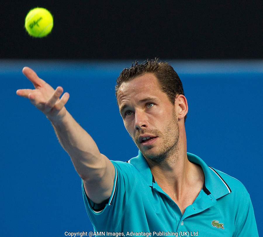 MICHAEL LLODRA (FRA) against ANDY MURRAY (GBR)  in the third round of the Men's Singles. Andy Murray beat Michael Llodra 6-4 6-2 6-0..21/01/2012, 21st January 2012, 21.01.2012..The Australian Open, Melbourne Park, Melbourne,Victoria, Australia.@AMN IMAGES, Frey, Advantage Media Network, 30, Cleveland Street, London, W1T 4JD .Tel - +44 208 947 0100..email - mfrey@advantagemedianet.com..www.amnimages.photoshelter.com.