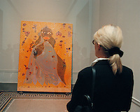 "A visitor to the Brooklyn Museum views ""The Holy Virgin Mary"" by Chris Ofili at the Sensation Show on September 30, 1999. The controversial painting, which uses elephant dung, was protected by a sheet of plastic suspended in front of the painting. Dennis Heiner was convicted of criminal mischief and fined $250 for defacing  the painting by smearing it with white paint(© Richard B. Levine)"