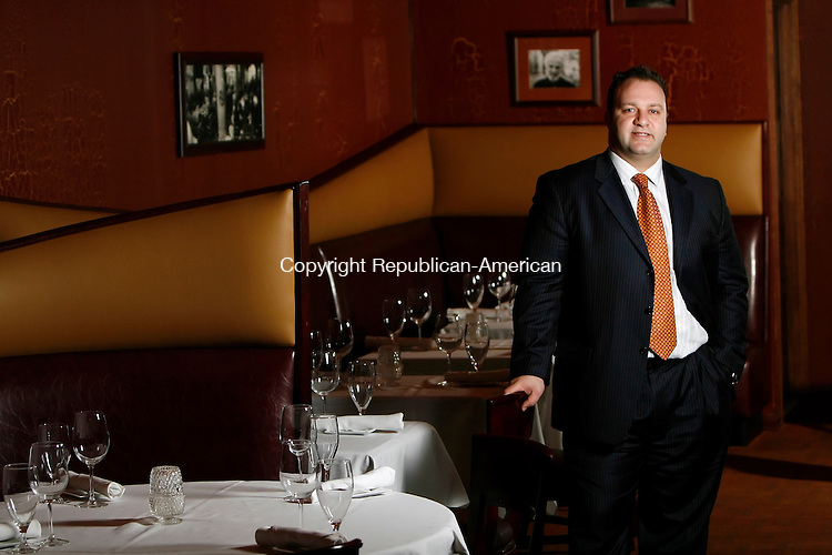 WATERBURY, CT, 02/04/08- 020409BZ07- Vasilias Kaloidis, owner/partner, poses in the dining room of Vintage Restaurant on Bank Street in Waterbury Wednesday. <br /> Jamison C. Bazinet Republican-American