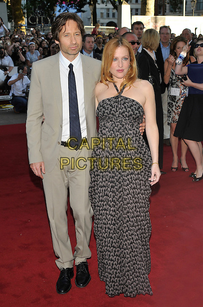 "DAVID DUCHOVNY & GILLIAN ANDERSON.Arrivals - ""The X-Files: I Want to Believe"".UK  film premiere held at Empire Cinema, Leicester Square, London, England, 30th July 2008..X files arrivals full length grey beige suit white shirt black tie print halterneck maxi dress pregnant peep toe heels shoes.CAP/PL.©Phil Loftus/Capital Pictures"