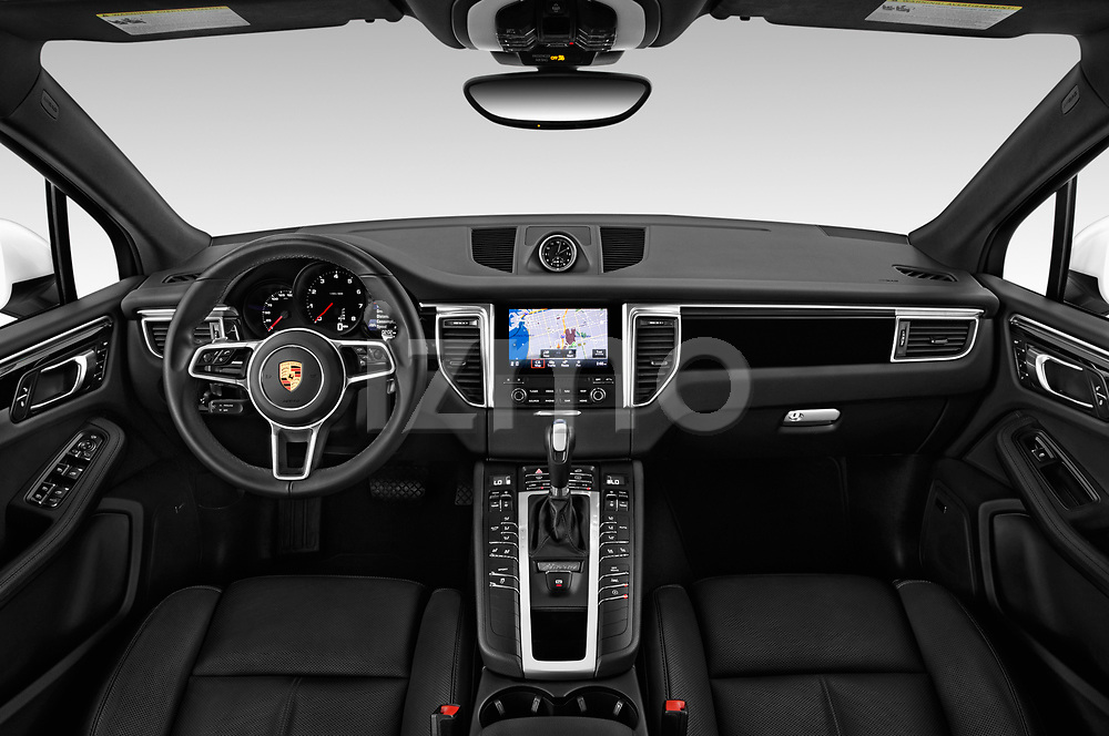 Stock photo of straight dashboard view of a 2018 Porsche Macan Base 5 Door SUV