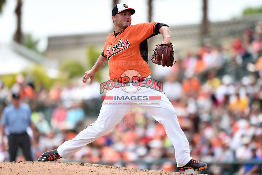 Baltimore Orioles pitcher Tommy Hunter (29) during a spring training game against the Pittsburgh Pirates on March 23, 2014 at Ed Smith Stadium in Sarasota, Florida.  Baltimore and Pittsburgh tied 7-7.  (Mike Janes/Four Seam Images)