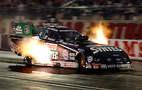 Apr 7, 2006; Las Vegas, NV, USA; NHRA Funny Car driver Eric Medlen launches off the starting line in the Castrol Syntec Ford Mustang during qualifying for the Summitracing.com Nationals at Las Vegas Motor Speedway in Las Vegas, NV. Mandatory Credit: Mark J. Rebilas