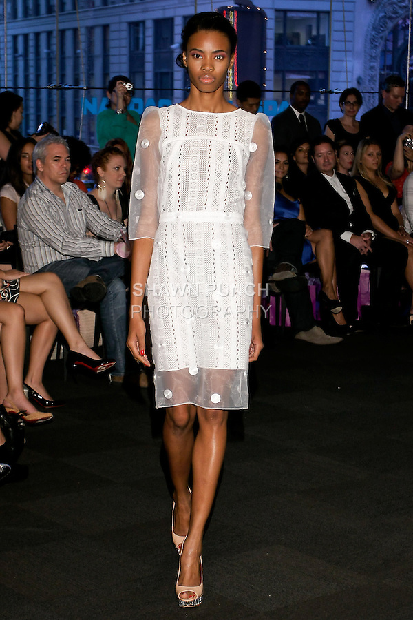 "Model walks runway in a white embroidered do dress, from the Yuna Yang Spring Summer 2013 ""Close your eyes and see the world"" collection, at the NASDAQ Marketsite, during New York Fashion Week, on September 7, 2012."