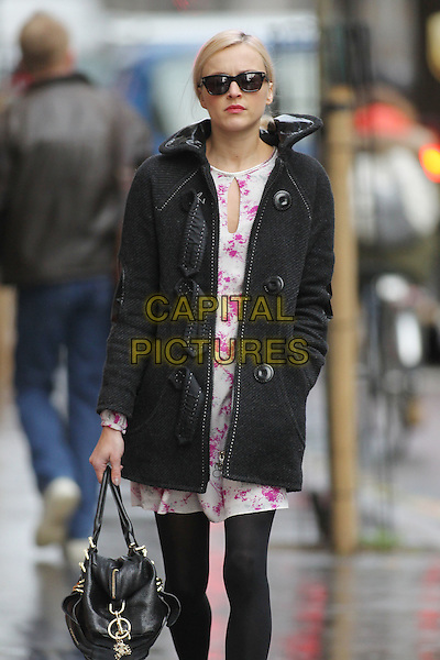 Fearne Cotton in central London, England..January 26th, 2012.half 3/4 length black tights jacket coat white pink pattern dress sunglasses shades bag purse hand in pocket.CAP/HIL.©John Hillcoat/Capital Pictures .