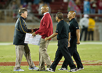 STANFORD, CA - August 31, 2012: San Jose St and Stanford head coaches Mike MacIntyre and David Shaw and the end of the Stanford Cardinal vs San Jose St. Spartans at Stanford Stadium in Stanford, CA. Final score Stanford Cardinal 20, San Jose St 17.