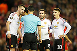 Morgan Schneiderlin, Juan Mata and Guillermo Varela of Manchester United confront the referee following the awarding of a penalty during the UEFA Europa League match at Anfield. Photo credit should read: Philip Oldham/Sportimage