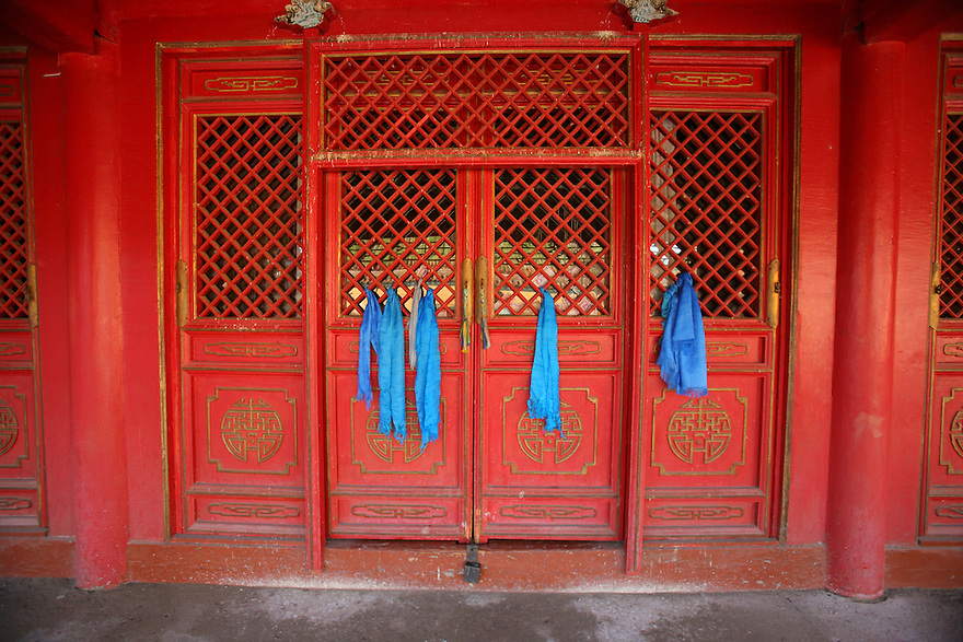 Blue silk ribbon on red doors. Amarbayasgalant Khiid Monastery Northern Mongolia