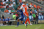 16 May 2015: Carolina's Kupono Low (right) heads the ball over New York's Walter Restrepo (20). The Carolina RailHawks hosted the New York Cosmos at WakeMed Stadium in Cary, North Carolina in a North American Soccer League 2015 Spring Season match. The game ended in a 2-2 tie.