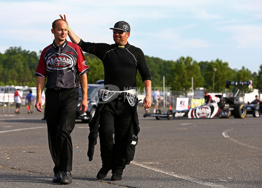 May 31, 2013; Englishtown, NJ, USA: NHRA top fuel dragster driver Shawn Langdon (right) jokes with a crew member during qualifying for the Summer Nationals at Raceway Park. Mandatory Credit: Mark J. Rebilas-