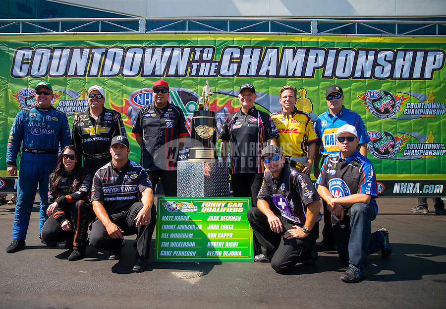 Sep 20, 2015; Concord, NC, USA; NHRA funny car drivers (front row from left) Alexis DeJoria , Matt Hagan , Jack Beckman , Robert Hight (back row from left) Tommy Johnson Jr , John Force , Cruz Pedregon , Tim Wilkerson , Del Worsham and Ron Capps pose for a photo as the drivers competing for the championship during the Carolina Nationals at zMax Dragway. Mandatory Credit: Mark J. Rebilas-USA TODAY Sports