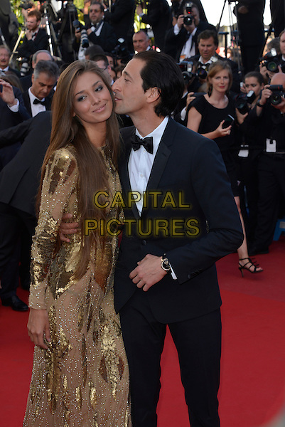Lara Lieto, Adrien Brody.'Cleopatra' premiere at the 66th  Cannes Film Festival, France..21st May 2013.half length gold dress sequins sequined black tuxedo couple profile kiss kissing .CAP/PL.©Phil Loftus/Capital Pictures.