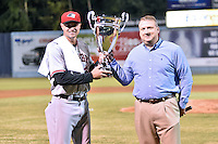 South Atlantic League president Eric Krupa presents the championship trophy to Hickory Crawdads manager Corey Ragsdale (24) after game 3 of the South Atlantic League Championship Series between the Asheville Tourists and the Hickory Crawdads on September 17, 2015 in Asheville, North Carolina. The Crawdads defeated the Tourists 5-1 to win the championship. (Tony Farlow/Four Seam Images)