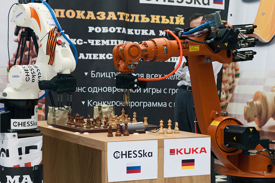 Moscow, Russia, 19/05/2012..The German-built KUKA Monster chess robot plays Russia?s CHESSka robot for the title of Absolute World Robot Chess Champion. The Russian robot, developed by chess coach Konstantin Kosteniuk, comprehensively defeated its opponent, created by KUKA Robotics, one of the world?s largest manufacturers of industrial robots.