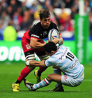 Michael Rhodes of Saracens fends Dan Carter of Racing 92. European Rugby Champions Cup Final, between Saracens and Racing 92 on May 14, 2016 at the Grand Stade de Lyon in Lyon, France. Photo by: Patrick Khachfe / Onside Images