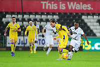 Joel Asoro of Swansea City U21 is fouled by Ed Upson of Bristol Rovers during the Checkatrade Trophy match between Swansea City U21 and Bristol Rovers at the Liberty Stadium in Swansea, Wales, UK. Wednesday 05 December 2018