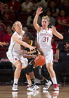 Stanford's Mikaela Ruef and Toni Kohenis box in a Long Beach State player during Saturday, November 25, 2012 game at Stanford.  Stanford won 77-41.