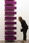 London, England. 15 October 2014. A visitor to Frieze Masters looks at the Untitled 1988 sculpture by Donald Judd, David Zwirner Gallery. Fine art fair Frieze Masters 2014 in Regent's Park, London. Photo: Bettina Strenske