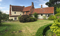 BNPS.co.uk (01202 558833)<br /> Pic: Sworders/BNPS<br /> <br /> Benton End in Suffolk - the former home of Cedric Morris.<br /> <br /> A painting that a friend of the British artist Sir Cedric Morris was allowed to take in a 'lucky dip' has sold for a record £204,000.<br /> <br /> The oil painting of foxglove flowers was pulled from out of the cellar at Sir Cedric's country house by the father of the vendor in the 1960s.<br /> <br /> Sir Cedric had apparently told the friend to 'have a dig around' in the basement to see what he could find.<br /> <br /> He took the 28ins by 23ins painting home with him and it remained in the family ever since.