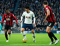 Tottenham Hotspur's Son Heung-Min shields the ball from  Bournemouth's Jefferson Lerma and Steve Cook<br /> <br /> Photographer Stephanie Meek/CameraSport<br /> <br /> The Premier League - Tottenham Hotspur v Bournemouth - Saturday 30th November 2019 - Tottenham Hotspur Stadium - London<br /> <br /> World Copyright © 2019 CameraSport. All rights reserved. 43 Linden Ave. Countesthorpe. Leicester. England. LE8 5PG - Tel: +44 (0) 116 277 4147 - admin@camerasport.com - www.camerasport.com