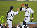 (L-R)  Hiroki Kokubo, Seiichi Uchikawa (JPN),<br /> MARCH 21, 2017 - WBC :<br /> Seiichi Uchikawa of Japan celebrates with manager Hiroki Kokubo at the dugout as he is replaced by a pinch-runner after hitting a singles in the eighth inning during the 2017 World Baseball Classic Semifinal game between United States 2-1 Japan at Dodger Stadium in Los Angeles, California, United States. (Photo by AFLO)