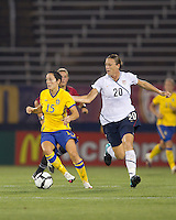Sweden midfielder Therese Sjogran (15) dribbles as US forward Abby Wambach (20) pressures. The US Women's national team beat Sweden, 3-0, at Rentschler Field on July 17, 2010.