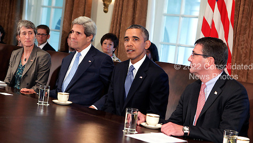 United States President Barack Obama presides over a cabinet meeting to discuss the possible government shutdown at the White House in Washington, DC, Monday, September 30, 2013. With Obama are Interior Secretary Sally Jewell (left), Secretary of State John Kerry (second left), and Deputy Secretary of Defense Ashton Carter.  <br /> Credit: Chris Kleponis / Pool via CNP