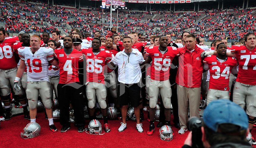 Ohio State Buckeyes head coach Urban Meyer locks arms with team as they sing the alma matter after the Ohio State Buckeyes Scarlet vs Grey spring game Saturday morning, April 21, 2012. The Scarlet team defeated the Gray team 20 - 14.  (The Columbus Dispatch / Eamon Queeney)