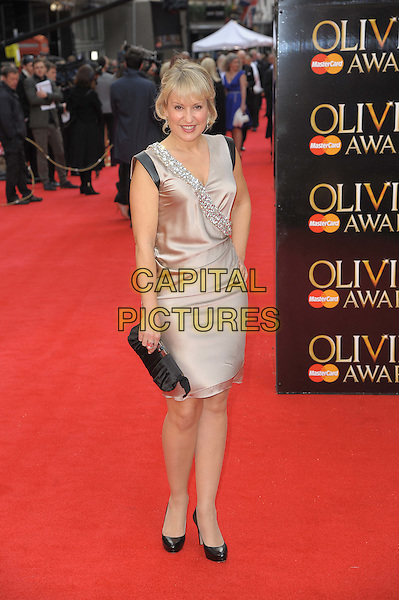 Nicki Chapman.The Olivier Awards 2012, Royal Opera House, Covent Garden, London, England..April 15th, 2012.full length dress beige wrap black clutch bag shoes embellished jewel encrusted  .CAP/CAS.©Bob Cass/Capital Pictures.