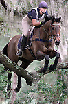 "Victoria Jessup, riding L'Cedric,  looks ahead as they clear a Live Oak limb called the ""Over the Agarista"" jump which was part of the preliminary course at the Red Hills Horse Trials in Tallahassee, Florida.."