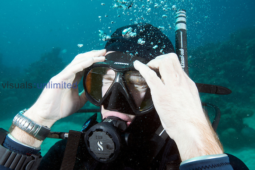 Student learning to scuba dive, demonstrating mask removal and clearing skill, Red Sea, Egypt