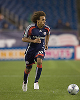 New England Revolution defender Kevin Alston (30) brings ball down the wing. The New England Revolution defeated San Jose Earthquakes, 2-1, at Gillette Stadium on August 29, 2009.
