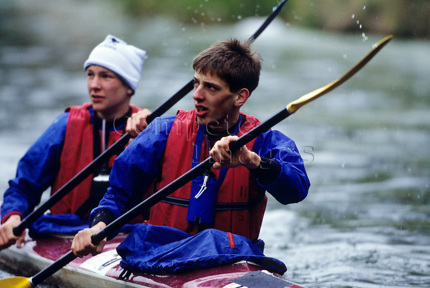 Two men Kayaking on a river